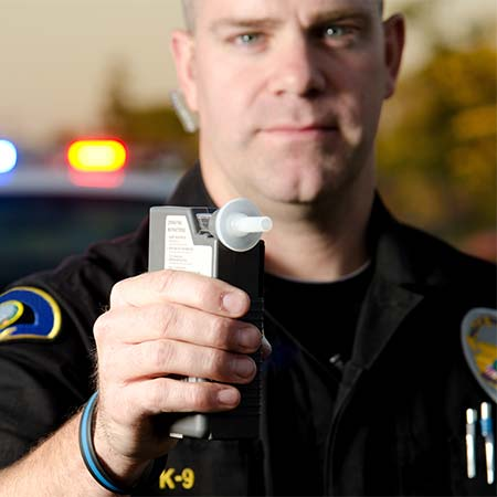 Police officer with breathilizer